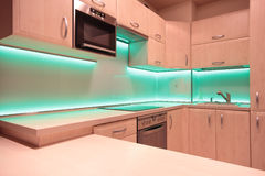 Modern luxury kitchen with green LED lighting Royalty Free Stock Images
