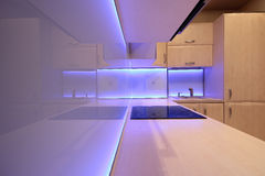 Modern luxury kitchen with purple LED lighting Stock Photos