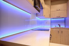 Modern luxury kitchen with purple LED lighting Stock Images