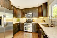 Modern luxury new dark brown and white kitchen. Royalty Free Stock Photo