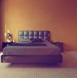 Modern luxury orange bedroom interior Royalty Free Stock Photo