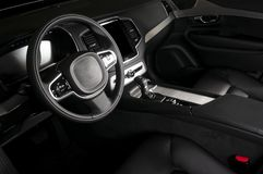 Modern luxury prestige car interior, dashboard, steering wheel. Black leather interior Royalty Free Stock Image