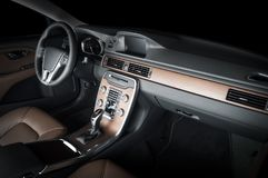 Modern luxury prestige car interior, dashboard, steering wheel. Black leather and red wood interior.  windows, clipping path included Royalty Free Stock Images