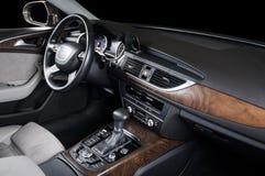 Modern luxury prestige car interior, dashboard, steering wheel. Black and white leather interior.  windows Stock Photography