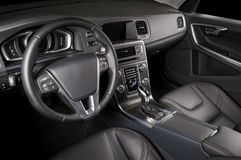 Modern luxury prestige car interior, dashboard, steering wheel. Black leather interior. Isolated windows, clipping path included Stock Photography