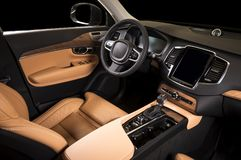 Modern luxury prestige car interior, dashboard, steering wheel. Orange red leather interior.  windows, clipping path included Stock Images