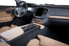 Modern luxury prestige car interior, dashboard, wood panels, steering wheel. Modern luxury prestige car interior, dashboard, steering wheel. Orange red Stock Photo