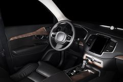 Modern luxury prestige car interior, dashboard, wood panels, steering wheel. Black leather interior.  windows, clipping path included Royalty Free Stock Photo