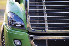 Modern luxury pro semi truck chromy grille and headlight Royalty Free Stock Photos