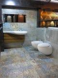 Modern luxury restroom toilet, mirror and bidet in bathroom Stock Photo