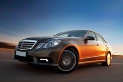 Modern luxury sedan. Driving fast Stock Photos
