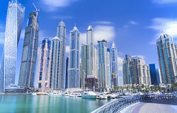 Modern and luxury skyscrapers in Dubai Marina. DUBAI, UNITED ARAB EMIRATES - MARCH 3, 2016: Modern and luxury skyscrapers in Dubai Marina Royalty Free Stock Photography
