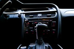Modern Luxury sport car inside. Interior of prestige car. Black Leather. Car detailing. Dashboard. Automatic gear stick shift leve. R. Buttons. Sound system royalty free stock photo