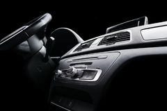 Modern Luxury sport car inside. Interior of prestige car. Black Leather. Car detailing. Dashboard. Media, climate and navigation c. Ontrol buttons. Sound system stock image