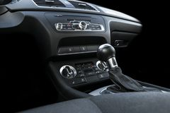 Modern Luxury sport car inside. Interior of prestige car. Black Leather. Car detailing. Dashboard. Media, climate and navigation c stock photo