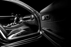 Modern Luxury sport car inside. Interior of prestige car. Black Leather seats with yellow stitching. Black perforated leather. Car. Interior details. Automatic royalty free stock image
