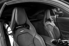 Modern Luxury sport car inside. Interior of prestige car. Black Leather seats with yellow stitching. Black perforated leather. Mod. Ern car interior details stock images