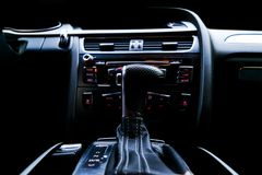 Modern Luxury sport car inside. Interior of prestige car. Black Leather. Car detailing. Dashboard. Automatic gear stick shift leve. R. Buttons. Sound system royalty free stock image