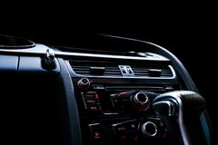 Modern Luxury sport car inside. Interior of prestige car. Black Leather. Car detailing. Dashboard. Media, climate and navigation c. Ontrol buttons. Sound system royalty free stock image