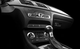 Modern Luxury sport car inside. Interior of prestige car. Black Leather. Car detailing. Dashboard. Media, climate and navigation c. Ontrol buttons. Sound system royalty free stock photo