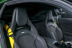 Modern Luxury sport car inside. Interior of prestige car. Black Leather seats with yellow stitching. Black perforated leather. Modern car interior details Stock Photography