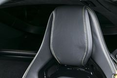 Modern Luxury sport car inside. Interior of prestige car. Leather seats with yellow stitching. Black perforated leather. Modern. Car interior details Royalty Free Stock Images