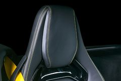 Modern Luxury sport car inside. Interior of prestige car. Leather seats with yellow stitching. Black perforated leather. Modern. Car interior details Stock Photography