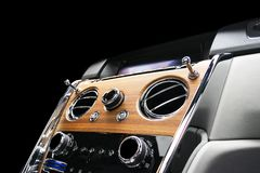 Modern Luxury sport car inside. Interior of prestige vehicle with natural wood panel. White Leather with stitching. Car detailing. royalty free stock images
