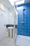 Modern luxury suite bathroom with shower. And roof window in blue Royalty Free Stock Photos
