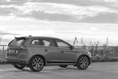 A modern luxury swedish car Volvo XC60 R-Design Polestar Edition on the roof of the building. Black and white royalty free stock photo