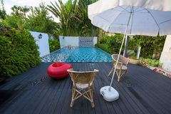 Modern luxury swimming pool with chairs Stock Images