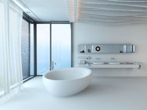 Modern lyxig badruminre med det vita badkaret Royaltyfri Foto