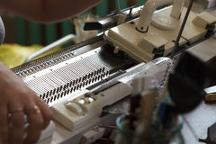 Modern machine for knitting on weaving mill Royalty Free Stock Photo