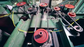 Modern machine works at a plant, rotating gears. 4K stock footage