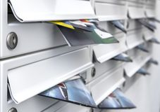 Free Modern Mailboxes Filled Of Flyers Stock Image - 133001061