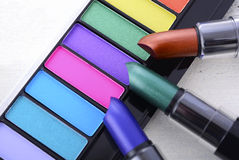 Modern makeup lipstick and eye shadow color range. Royalty Free Stock Photo
