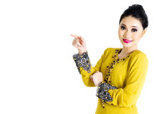 Modern malay woman. Malay woman pointing her finger on the side royalty free stock photo