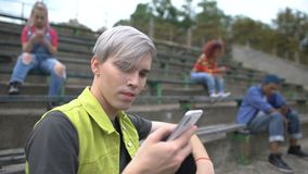 Modern male teenager chatting online by smartphone application, gadget addiction. Stock footage stock video
