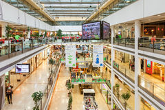 Modern mall interior view. PRAGUE, CZECH REPUBLIC - SEPTEMBER 23, 2015: Palac Flora shopping mall interior. Opened in 2003, contains 4 floors, 120 shops, Cinema Royalty Free Stock Photography
