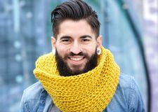 Modern man with beard. Close up portrait of a young modern man with beard smiling royalty free stock image