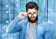 Modern man with beard and glasses. Horizontal portrait of a handsome modern man with beard and glasses stock image