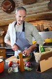 Modern man cooking with help of internet Royalty Free Stock Photography