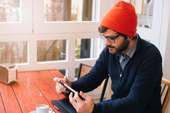 Modern man with tablet in a cafe Stock Photo