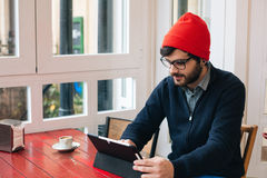 Modern man with tablet in a cafe Royalty Free Stock Images