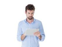 Modern man using his tablet Royalty Free Stock Photos