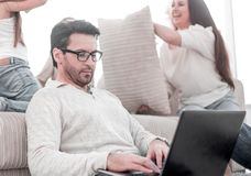 Modern man work on a laptop at his home royalty free stock image