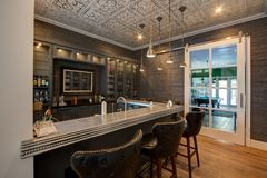 Modern Mansion Cocktail Bar. Spacious modern mansion family alcohol cocktail and beer bar lounge with server bar and wood flooring stock images