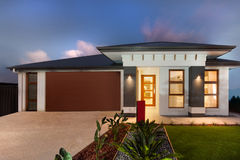 Modern mansion with a garage showing the front side Royalty Free Stock Photos