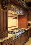 Modern mansion kitchen range. Modern kitchen range in multi-million dollar mansion royalty free stock images