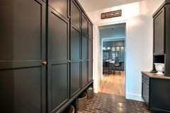 Modern Mansion Storage Cabinets. Spacious modern mansion family home with huge amount of storage cabinets Stock Image